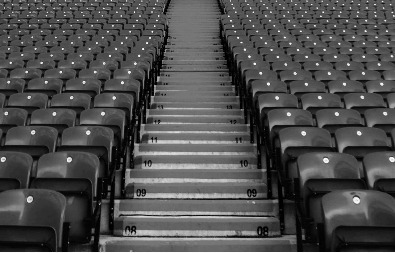 A wide photograph showing empty football stadium seats