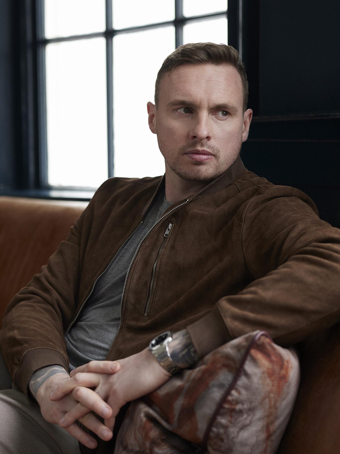 David Stockdale sitting on a leather sofa