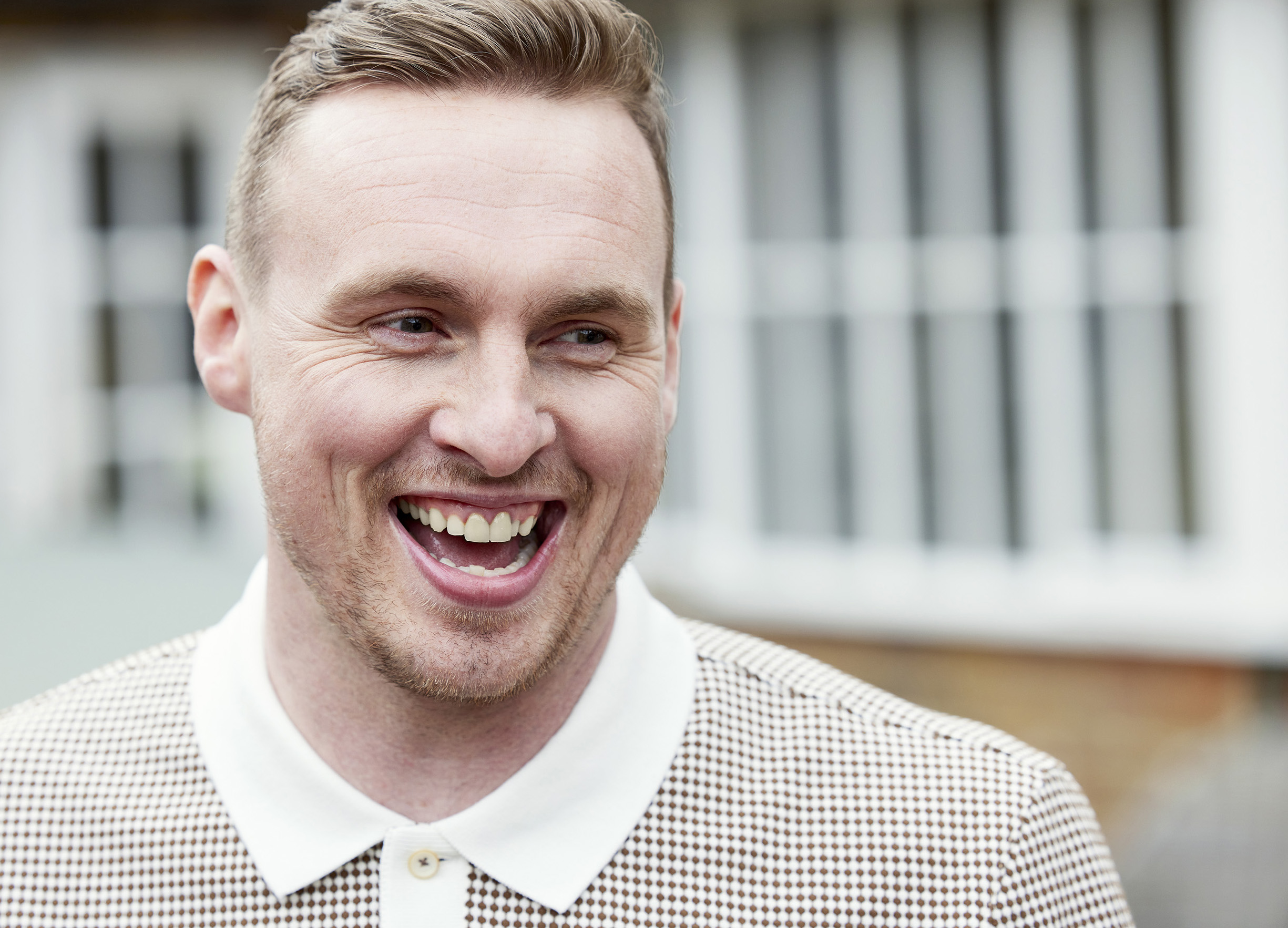 A close up of David Stockdale laughing