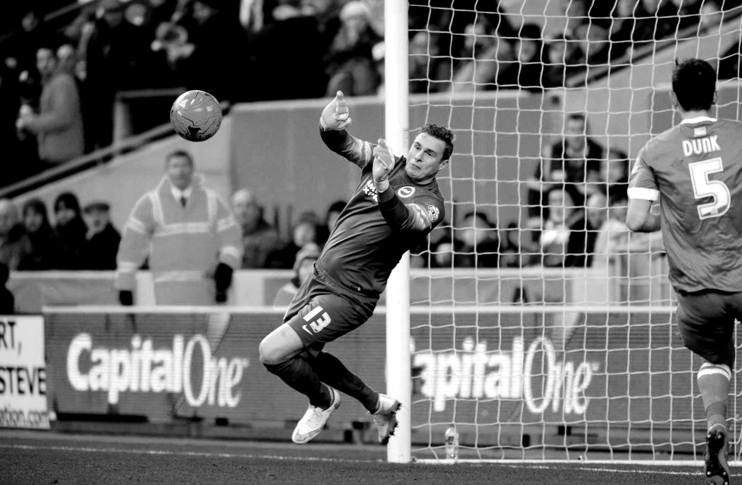 David Stockdale saving a football