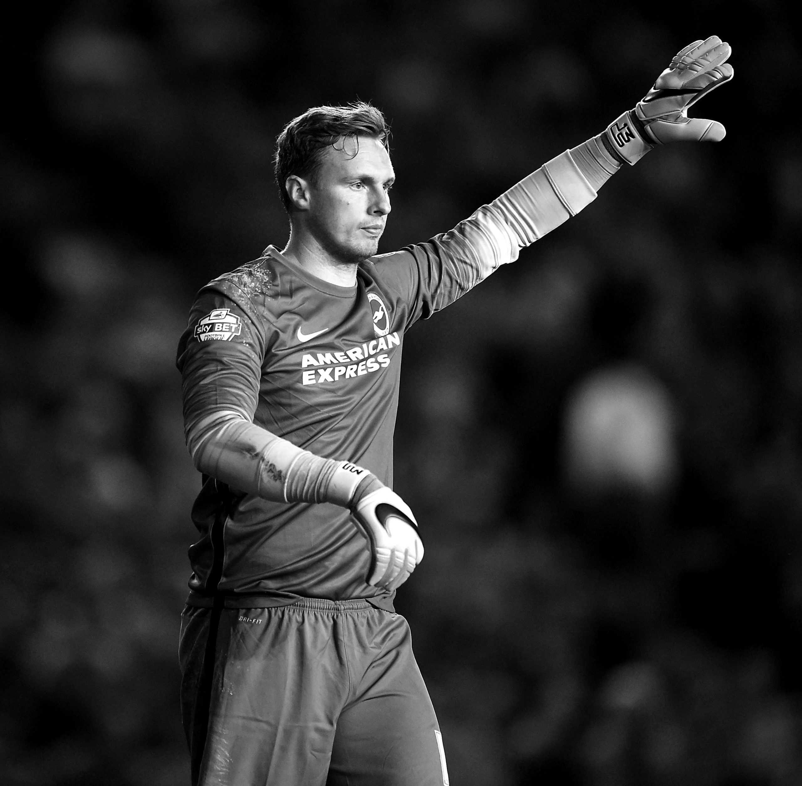David Stockdale on the pitch, holding his hand up in the air asking for the ball